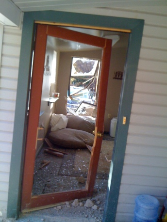 The 2010 Rockfall: In the porch door and out the window.